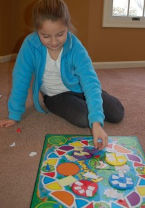 girl in blue with game
